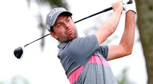 Webb Simpson looks to be cruising to victory at The Players Championship golf tournament at TPC Sawgrass