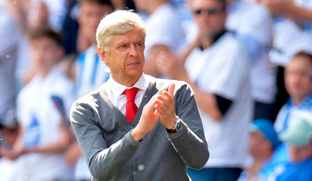 Arsenal manager Arsene Wenger applauds the fans during the match