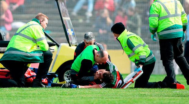 Tom Parsons of Mayo receives medical attention during the Connacht GAA Football Senior Championship Quarter-Final match between Mayo and Galway at Elvery's MacHale Park in Mayo. Photo by David Fitzgerald/Sportsfile