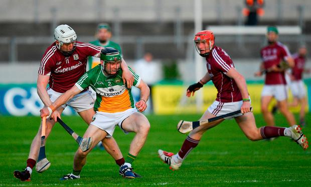 Tom Spain is put under pressure by Joe Canning, left, and Conor Whelan. Photo: Ray McManus/Sportsfile