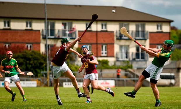 Meath's Joe Keena gets a shot away despite the efforts of Darragh Clinton. Photo: Sam Barnes/Sportsfile