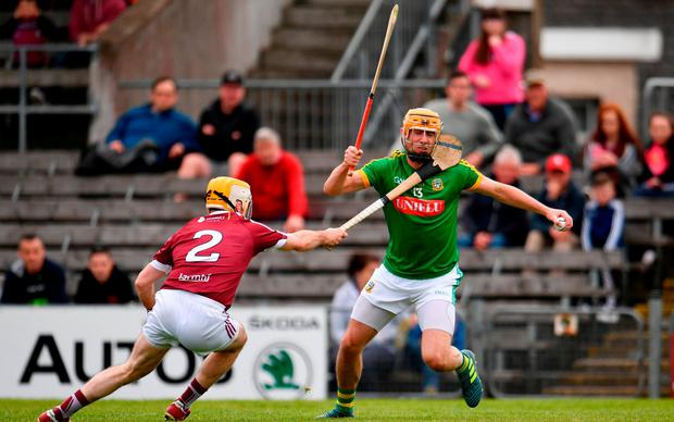 Meath's Alan Douglas breaks through a challenge from Shane Power. Photo: Sam Barnes/Sportsfile