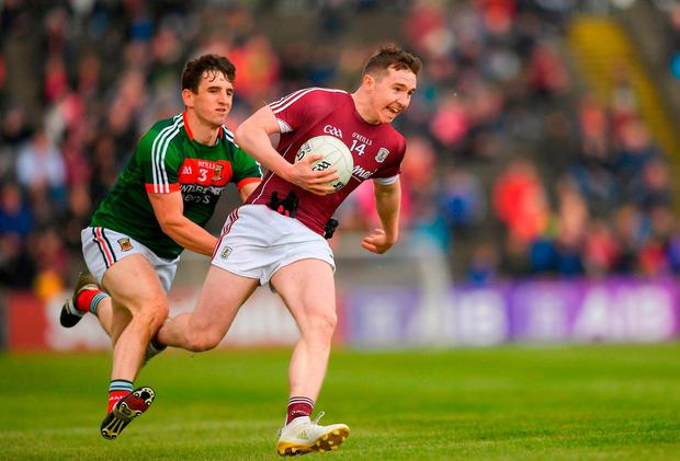 Galway's Pádraic Cunningham breaks away from Mayo's James O'Dowd. Photo: Eóin Noonan/Sportsfile