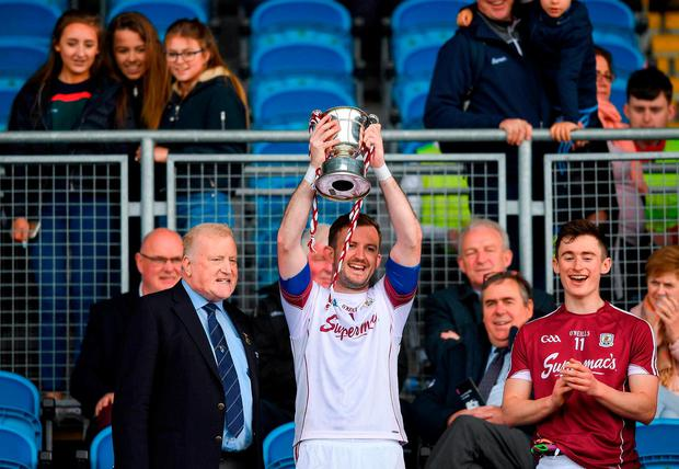 Maghnus Breathnach of Galway lifting the cup after the Junior Championship Semi-Final match between Mayo and Galway at Elvery's MacHale Park in Mayo. Photo: Eóin Noonan/Sportsfile