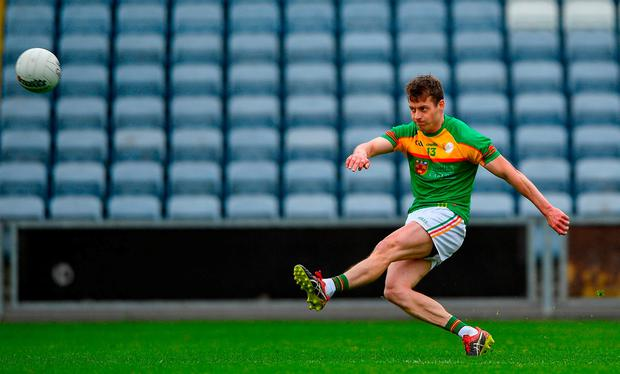 Carlow's Paul Broderick kicks a point from a free. Photo: Harry Murphy/Sportsfile