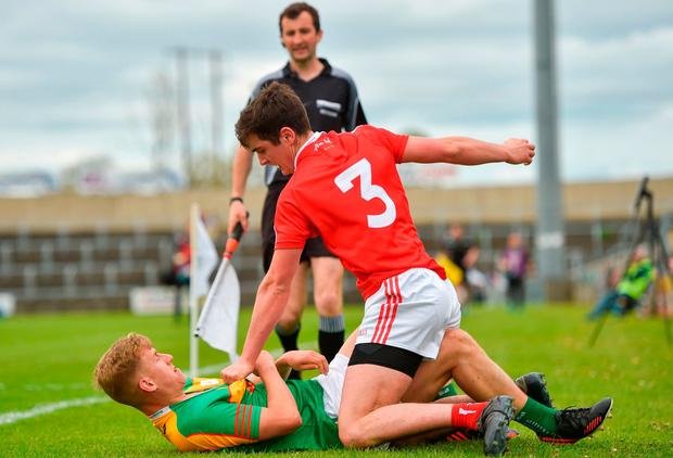 Emmet Carolan of Louth clashes with Carlow's Darragh O'Brien. Photo: Harry Murphy/Sportsfile