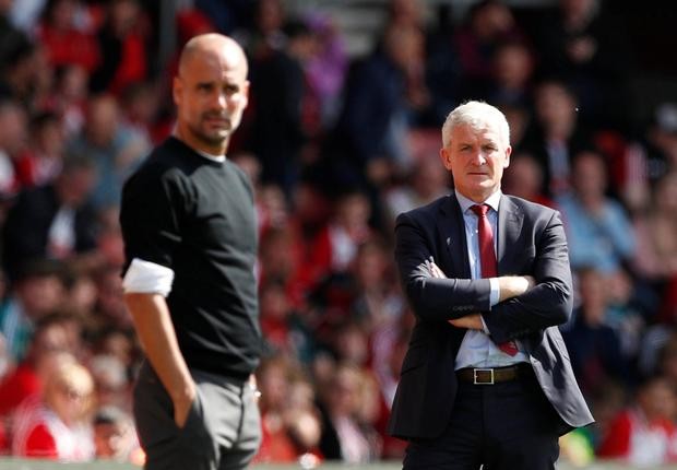 Manchester City manager Pep Guardiola and Southampton manager Mark Hughes. Photo: Reuters