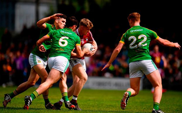 Luke Loughlin of Westmeath is crowded out by Donal Lenihan, Donal Keogan and Conor Dempsey. Photo: Sam Barnes/Sportsfile
