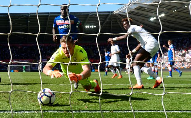 Stoke's Jack Butland makes a save on the goal-line. Photo: Reuters