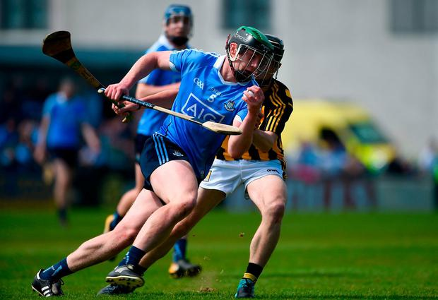 Dublin's Eoin Carney keeps possession under pressure from Kilkenny's Conor Kelly. Photo: Daire Brennan/Sportsfile