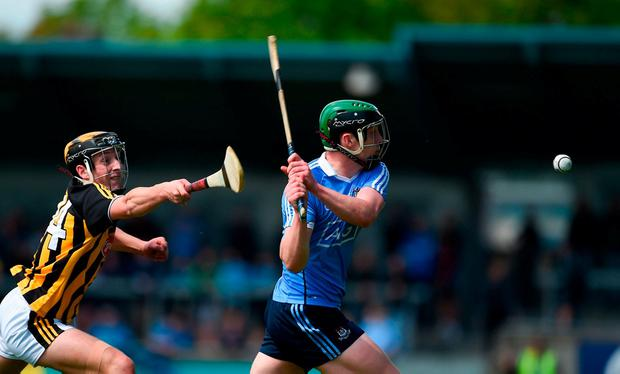 Dublin's Eoin Carney gets a shot away despite the efforts of Jack Morrissey. Photo: Daire Brennan/Sportsfile