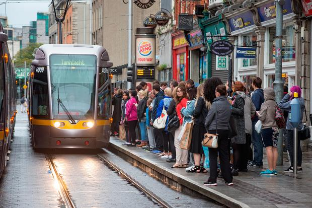 Passengers waiting to board a Luas at Abbey Street Picture: Arthur Carron