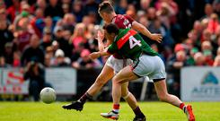 Johnny Heaney buries the ball to the net under pressure from Keith Higgins for the crucial goal in Galway's victory over Mayo. Photo: Eóin Noonan/Sportsfile