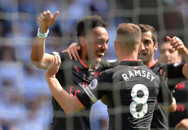 Arsenal's Pierre-Emerick Aubameyang celebrates scoring his side's first goal with Henrikh Mkhitaryan and Aaron Ramsey. Photo: Reuters