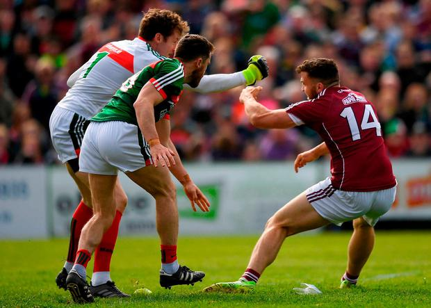 Galway's Damien Comer during a coming together with David Clarke and Chris Barrett. Photo: Eóin Noonan/Sportsfile
