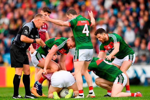 Mayo and Galway battle it out last year