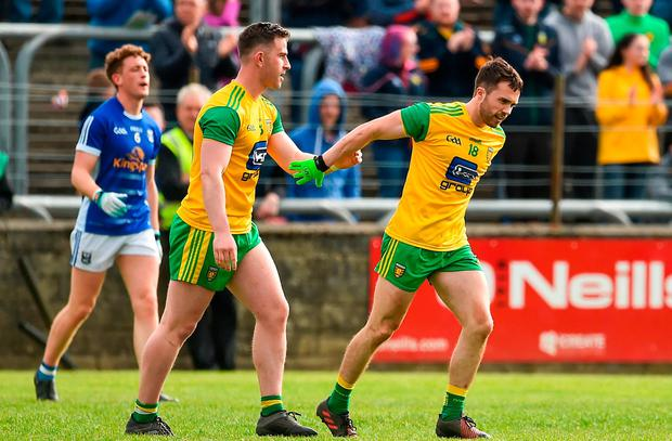 Cian Mulligan, right, is congratulated by teammate Patrick McBrearty after scoring Donegal's second goal. Photo: Oliver McVeigh/Sportsfile