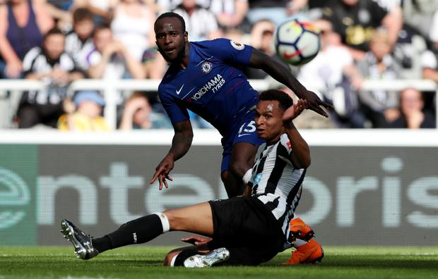 Chelsea's Victor Moses challenges with Newcastle's Jacob Murphy. Photo: Reuters