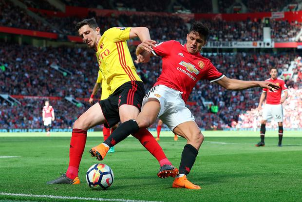 Watford's Craig Cathcart and Manchester United's Alexis Sanchez battle for the ball. Photo: PA