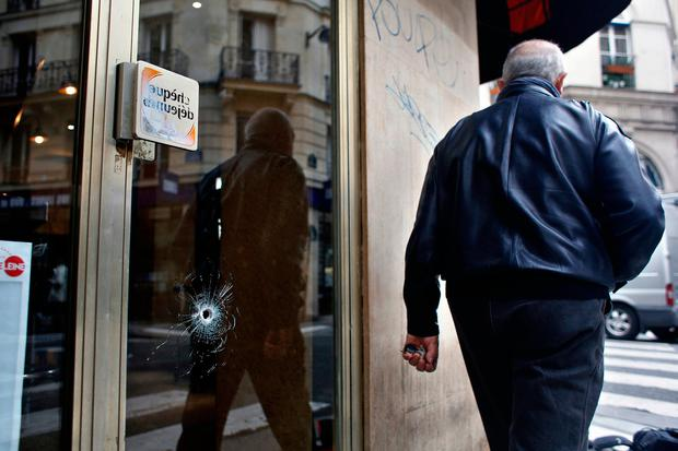 A bullet hole seen on the window of a cafe located near the area where the assailant of a knife attack was shot dead by police officers. Photo: AP Photo/Thibault Camus