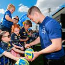 From left: Johnny Sexton signing autographs for fans in Donnybrook Photos: Frank McGrath