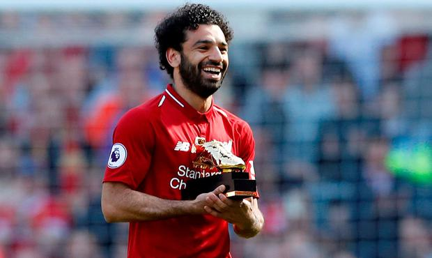 Liverpool's Mohamed Salah celebrates with the Golden Boot after yesterday's win over Brighton