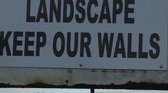 Signs erected highlighting concern at new roads plan.