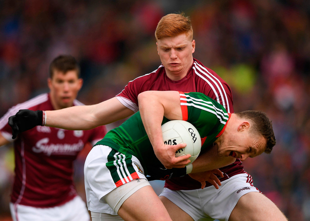 13 May 2018; Andy Moran of Mayo is tackled by Sean Andy Ó'Ceallaigh of Galway during the Connacht GAA Football Senior Championship Quarter-Final match between Mayo and Galway at Elvery's MacHale Park in Mayo. Photo by Eóin Noonan/Sportsfile