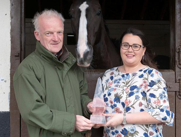 Willie Mullins receives the Philips Lighting Sports Manager of the Month award for April from Catherine Lambe of Philips Lighting Ireland. Photo: Thomas Nolan Photography