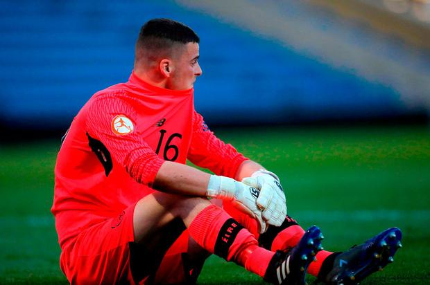 Ireland U-17 goalkeeper reacts after he was sent off during the penalty shoot. Photo: SPORTSFILE