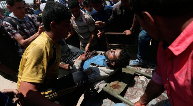 Israeli forces kill at least 58 people and injure 2,700 in Gaza 'massacre'