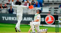 Kevin O'Brien of Ireland, right, reacts after being caught by Haris Sohail of Pakistan