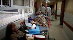 An injured Palestinian lies on a bed in the corridor of a hospital in Gaza City May 15, 2018. REUTERS/Mohammed Salem