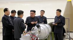 North Korean leader Kim Jong Un provides guidance with Ri Hong Sop (3rd L) and Hong Sung Mu (L) on a nuclear weapons program in this undated photo released by North Korea's Korean Central News Agency (KCNA) in Pyongyang September 3, 2017. KCNA via REUTERS/File Photo