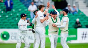 Ed Joyce (second right) celebrates with his Ireland team-mates after catching out Haris Sohail of Pakistan, off a delivery from Boyd Rankin (centre), during the final day of the Test in Malahide. Photo: Seb Daly/Sportsfile