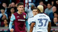 Soccer Football - Championship Play Off Semi Final Second Leg - Aston Villa v Middlesbrough - Villa Park, Birmingham, Britain - May 15, 2018 Aston Villa's Jack Grealish clashes with Middlesbrough's Adama Traore. Action Images via Reuters/Ed Sykes