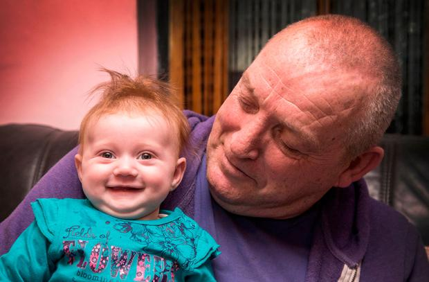 Lily Rose Kenny – who was only a day old when her mother Nicola was killed – with her granddad Paddy at their home in Thurles, Co Tipperary. Photo: Colin O'Riordan