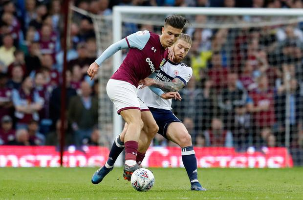 Aston Villa's Jack Grealish battles with Middlesbrough's Adam Clayton during last night's play-off. Photo: PA Wire