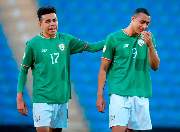 Ireland youngsters Tyriek Wright (left) and Adam Idah console each other after the UEFA U-17 quarter-final defeat to Netherlands. Photo: Sportsfile