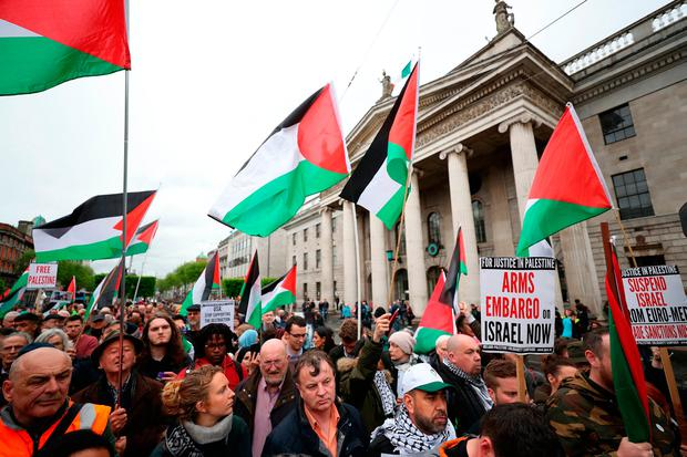 Protesters attend a rally called by the Ireland-Palestine Solidarity Campaign (IPSC) on O'Connell Street in Dublin after more than 60 Palestinians were killed and about 2,000 injured by Israeli forces during protests on Monday. Niall Carson/PA Wire