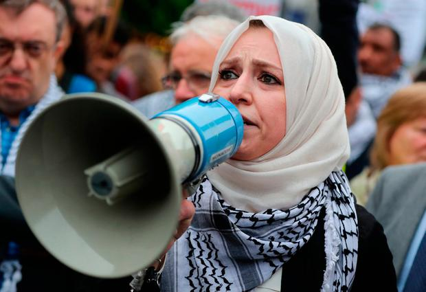 Ireland-Palestine Solidarity Campaign (IPSC) chair Fatin Al Tamimi speaks at a rally called by the group on O'Connell Street in Dublin after more than 60 Palestinians were killed and about 2,000 injured by Israeli forces during protests on Monday. Niall Carson/PA Wire