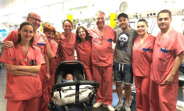 David Silva poses for a photo with hospital staff who cared for his son, Mateo (centre) CREDIT: DAVID SILVA TWITTER