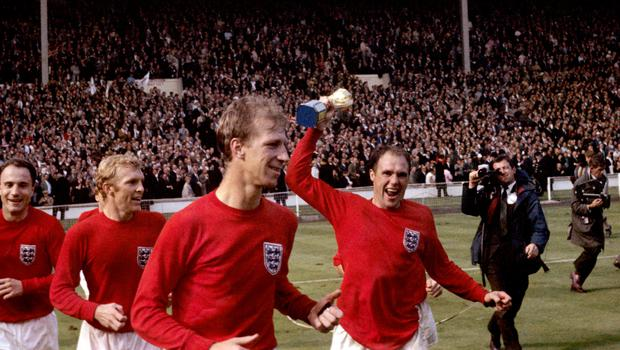 (l-r) England's George Cohen, Bobby Moore, Jack Charlton and Ray Wilson (with trophy) celebrate after winning the World Cup in 1966