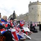Royal fans hold their spaces after sleeping on the pavement outside of Windsor Castle, the location for the forthcoming wedding of Britain's Prince Harry and his fiancee Meghan Markle, in Windsor, Britain, May 16, 2018. REUTERS/Toby Melville