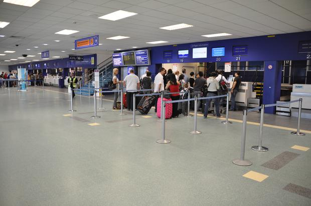 Passengers at Cardiff airport at check-in desks