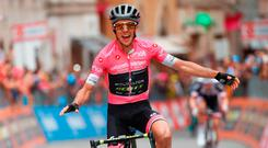 Simon Yates celebrates his stage win after a gruelling uphill finish. Photo: Getty Images