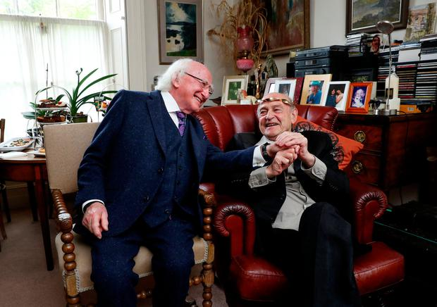 Murphy with President Michael D Higgins last year. Photo: Maxwells