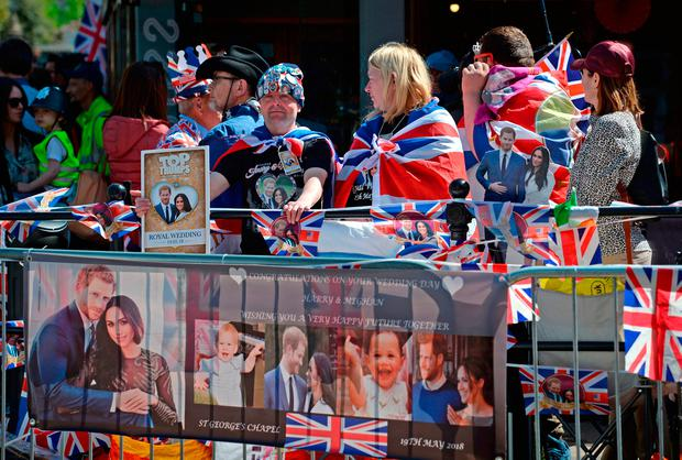 Royal fans wait to watch members of the armed forces in a parade rehearsal in Windsor, Berkshire ahead of the wedding of Prince Harry and Meghan Markle this weekend. PRESS ASSOCIATION Photo. Picture date: Thursday May 17, 2018. See PA story ROYAL Wedding. Photo credit should read: Kirsty O'Connor/PA Wire