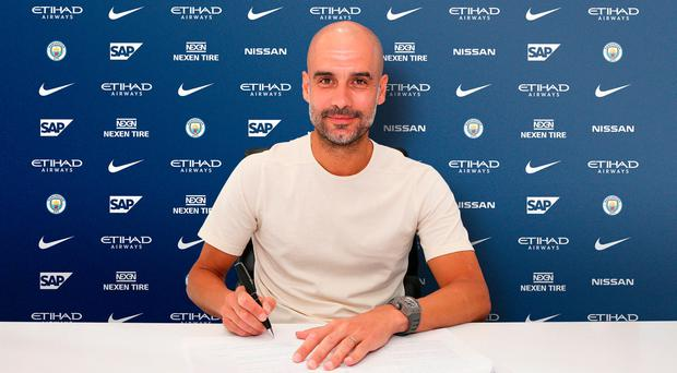 Pep Guardiola signs new contract extension with champions Manchester City