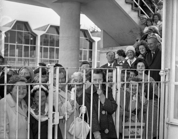 Royal watch: Crowds gather at Dublin Airport in the early 1960s to see Princess Margaret and her husband Lord Snowdon leave following their visit to Ireland, the first by a British royal for more than three decades